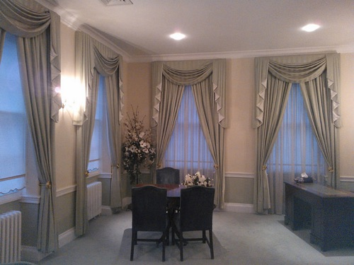 Traditionally elegant swags and tails in Portsmouth Registry Marriage Room, made in a Sanderson damask stripe, with tails contrast lined.
